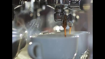 фокус : Preparation of americano on a coffee machine