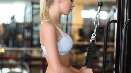 bra : beautiful young woman is doing exercises at the gym
