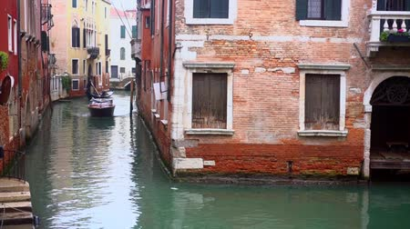 italia : Venetian channel with ancient houses and boats Stock Footage