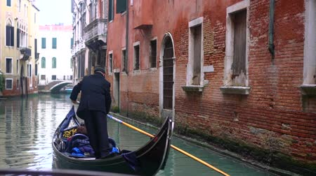 grande : Venetian channel with ancient houses and boats Stock Footage