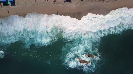 Aerial View From Flying Drone Of Relaxing People