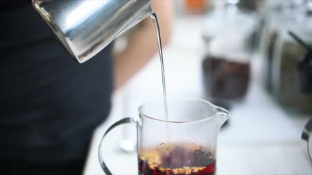 morning : Barista making tea in French press, close view