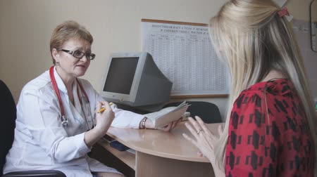 counsel : Doctor talking with patient in office, office. Patient medical advice for a healthy lifestyle .consultation with a doctor Stock Footage