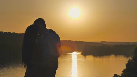 amantes : the embrace of lovers at sunset. Kisses in the sun.