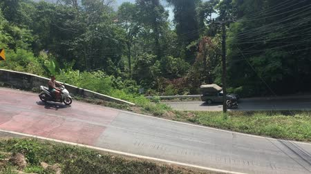 rota : Cars and bikes rides on extremely dangerous sharp curve in Thailand