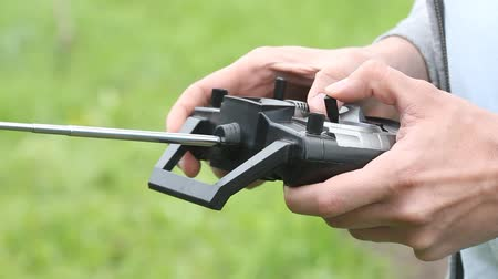 ahize : Piloting Radio controlled helicopter with remote control. Hands holding a transmitter Stok Video