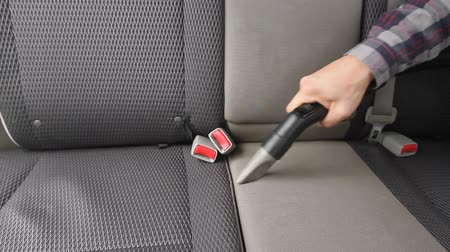 garagem : Chemical cleaning of Cars interior textile seats with professionally vacuum cleaner