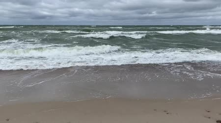 Moving surface and waves of cold baltic sea in stormy weather