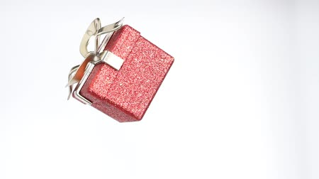 Christmas and New Year red box. Rotating decoration on white background. Merry Christmas and a Happy New Year!