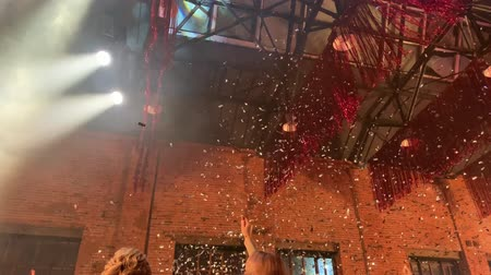 Confetti fired in air on a party. Confetti flying in the air at the night.