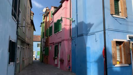 BURANO, ITALY - JANUARY 20, 2020: Colorful houses on the island of Burano in Italy. Burano island is famous for its colorful fishermans houses.