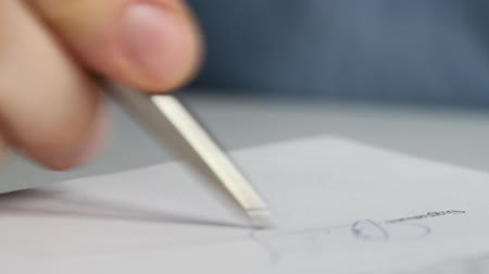 Closeup shot of a business man signing a contract, legal agreement or paper. Man is approve documents by signing papers.