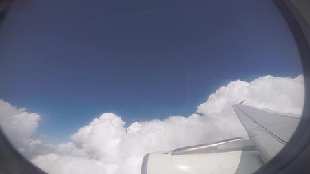 Flying into the white cloud, cloud scape when looking through the airplane window 影像素材