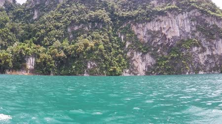 Mountain and water view when travel on boat for sightseeing in Cheow Lan reservoir in Surat Thani province, Thailand.