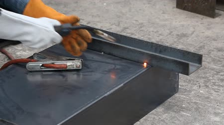 Worker uses gas metal arc welding (especially metal inert gas or MIG welding) to fix the workpieces