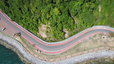 Aerial view from drone of coastal road with bike lane to Nang Phaya Hill Scenic Point in Chanthaburi, Thailand 影像素材