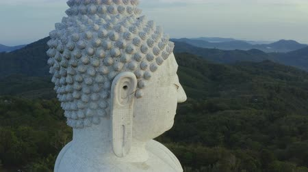 Phuket big Buddha head on high mountain Phuket Big Buddha is one of the island most important and revered landmarks on the island. Стоковые видеозаписи