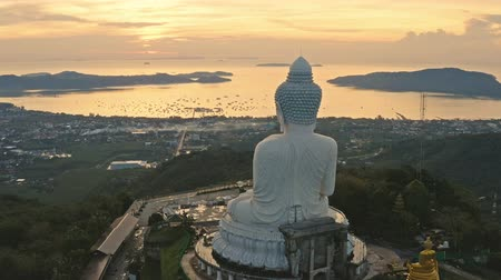 sunrise light : Phuket Big Buddha is one of the island most important and revered landmarks on the island. big Buddha is on the top of high mountain can see around the Phuket island when you are there