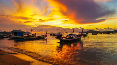 fisherman : time lapse scenic reflection of beautiful sunshine in the sea fishing boats are on the mud in the Rawai sea
