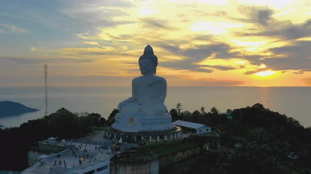 Time lapse aerial view sunset at Phuket big Buddha is one of the island most important and revered  landmarks on Phuket island.