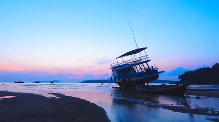 emperrado : time lapse sunrise above Rawai sea shipwreck parking on Rawai beach beside a small canal