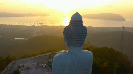 scenery aerial photography sunrise at Phuket big Buddha. Phuket Big Buddha is one of the island most  important and revered landmarks on Phuket island. Стоковые видеозаписи