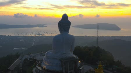 resolution : scenery aerial photography sunrise at Phuket big Buddha. Phuket Big Buddha is one of the island most  important and revered landmarks on Phuket island. Stock Footage