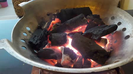 The fire in the charcoal stove.