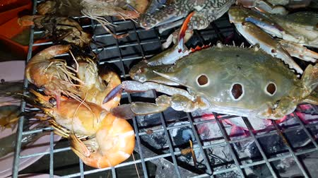 Grilled seafood on charcoal grills