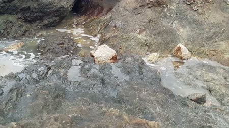 Sea waves hit the rocks and splashed water. Stok Video