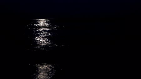 holdfény : Shot of the ocean at night with moonlight reflected on the waters surface