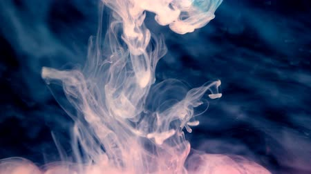 a Smoke effect is created by dropping milk in water