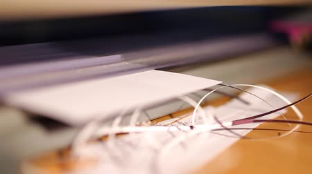 focus on foreground : A craft Guillotine cuts paper on a desk