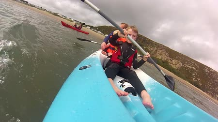 father of waters : A family sets out to kayak in the sea in Abersoch,  Wales