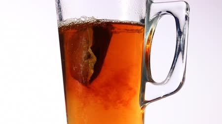 A close up of a glass of tea being made