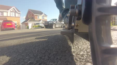 GoPro shot from the wheel of a scooter as it travels through the suburbs Vídeos