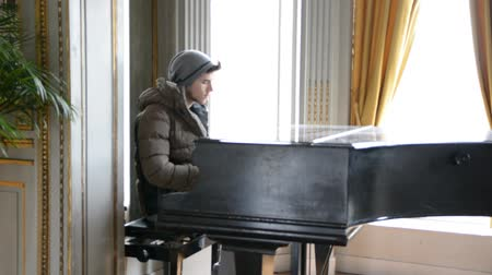 piyano : Young handsome male artist playing classical piano Stok Video