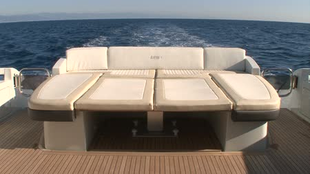 żaglówka : Exterior sofa of luxury yacht navigating slowly Wideo