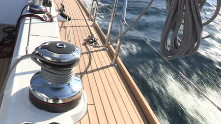 barco : On board view of lateral side of sailing boat, with detail of the winch