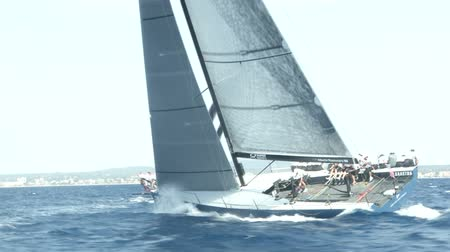 моряк : Sailing boats navigating fast with open sails during regatta