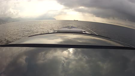 tengeri élet : Bow and roof of luxury boat navigating at the sunset