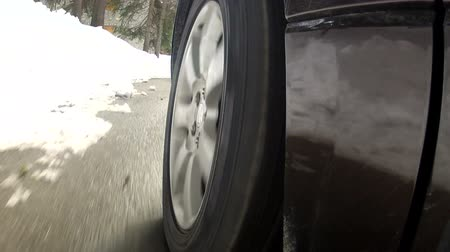 pneus : Detail of wheel of off road car going on snowy road  Stock Footage