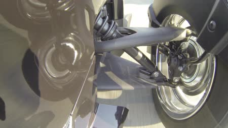 cycle : Front wheel of 3-wheels motorcycle going fast, with view of the suspensions  Stock Footage