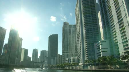 Майами : Skyscrapers in downtown Miami seen from a navigating boat  Стоковые видеозаписи