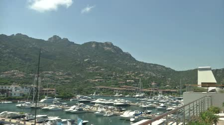 prestigious : Porto Cervo marina seen from the Yacht Club Costa Smeralda, one of the most prestigious yacht club in the world, on August 30, 2013 in Porto Cervo, Italy Stock Footage
