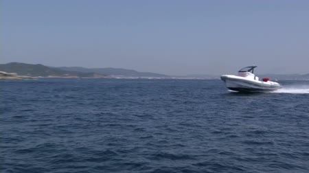 lancha : Maxi rib navigating fast in front of a lighthouse in Ibiza, Spain