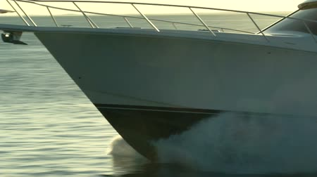 Brand new luxury fishing boat navigating at the sunset in Miami Wideo