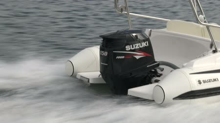 pervane : Outboard engine on a rib navigating fast