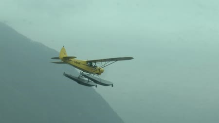 hydroplane : Float plane flying on Como lake seen from another plane