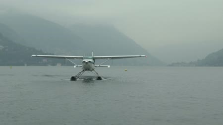 hydroplane : Float plane navigating on Como lake seen from another plane Stock Footage